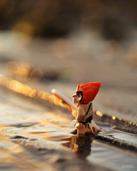 Lego Leonidas about to go surfing at sunset WM